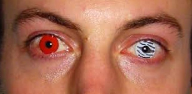 man wearing different Halloween contact lens in each eye